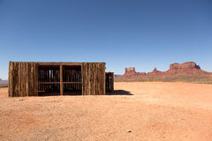 Shack in the desert with mesa and butte in the background. Wooden shack in the desert with mesa and butte in the background Royalty Free Stock Photos