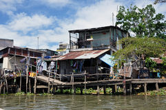 Shack home in Can Tho, Mekong delta, Vietnam. CAN THO - FEB 17: Typical shack home along the Mekong Delta. People from the slum area are living in poverty with a royalty free stock image