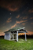 Shack on a meadow at night Stock Image