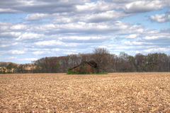 Shack in Vast Field Stock Images