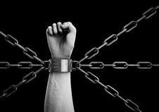 Shackled. 3D render of hand shackled with multiple chains Royalty Free Stock Photo