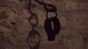 Shackled Hand holder at dungeon. Shackled Hand holder at deep dungeon cave stock footage