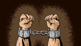 Shackled hands Stock Photo
