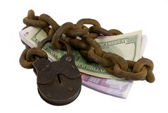 Shackled money under lock and key Stock Images