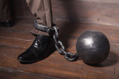 Shackles on his leg. Royalty Free Stock Photo