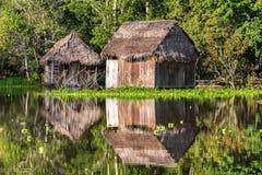 Shacks Reflected in the Amazon Stock Photo