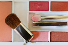 Shade. A cosmetic pallete with sponge stick and brush Royalty Free Stock Photos
