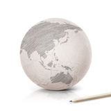 Shade Asia & Australia map on paper globe. On white background royalty free stock photo