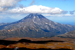 In a shade of clouds. Kind on a volcano Viljuchinsky from a volcano Burnt. The Kamchatka peninsula, autumn, a photo it is made during an ascension on a volcano Stock Images
