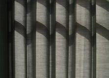Shade on Grey Curtain Stock Photos