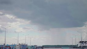 Shade of light rain approaches the quay of the marina stock video footage