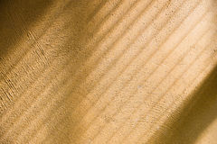 Shade and light from window on rough wall. Diagonal shade and light from window curtain onto yellow rough surface wall Stock Photo