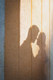 Shade loving couple at the time of the kiss. Concept  love and romance Stock Photo