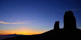 Silhouette of Roque Nublo at sunset, Gran canaria island. Sundown on Roque Nublo, from Gran canaria, Canary islands Stock Image