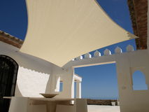 Shade sail in Morocco. Shade sail installed in the courtyard of a Moroccan Riad stock photos