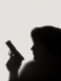 Shade of stranger with a pistol. Shade of woman  with a pistol on a white background Royalty Free Stock Photography