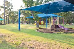Shade structure playground Houston, Texas, USA. Collection of sun shade playgrounds and facilities at grassy public park in Houston, Texas, USA. Safe, comfort royalty free stock photography