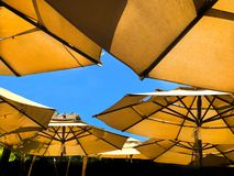 Shade Umbrella Outdoor Cafe. Tranquil outdoor cafe at Lahania, Maui, Hawaii. Shade umbrellas protect diners from the hot mid day sun stock image