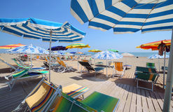 Shade of the umbrellas on the beach of the tourist village by th Stock Photos