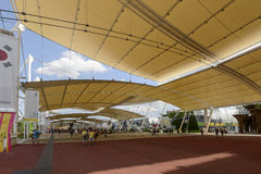 Shade under tensile membrane on Decumano , EXPO 2015 Milan. MILAN, ITALY - July 09: EXPO 2015, shade under the sails of membrane textile structure covernig the Royalty Free Stock Photos