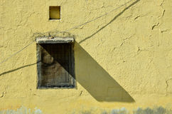 The shade of the window. And yellow old wall Stock Images