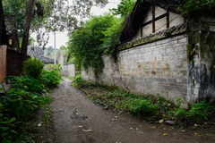 Shaded alley between ancient Chinese dwelling buildings Stock Photography