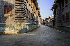 Shaded alley between archaised Chinese traditional buildings in Royalty Free Stock Photo