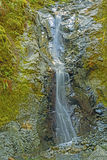 Shaded Cascade in the Wilderness Royalty Free Stock Photos