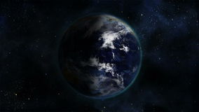 Shaded and cloudy Earth turning on itself with Earth image curtesy of Nasa.org stock footage