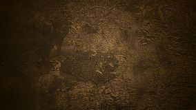 Shaded deep brown background. Old cracked surface. Aged flaking dyed leather texture. Peeled skin texture under soft yellow light stock photos