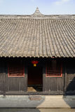 Shaded doorway of aged Chinese house on sunny day Royalty Free Stock Photos