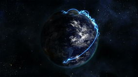 Shaded Earth turning on itself with moving clouds and blue connections with Earth image courtesy of stock video footage