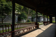 Shaded gallery in Chinese ancient style on sunny day Royalty Free Stock Photo