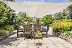 Shaded garden corner providing rest from summer heat Stock Image