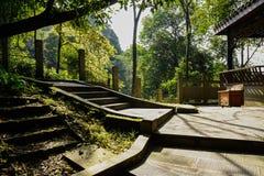 Shaded mountainside stone steps before gazebo in sunny winter Stock Images