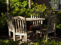Shaded Outdoor Table & Chairs Royalty Free Stock Photos