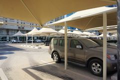 Shaded parking lot covers luxurious vehicles in Doha stock photo