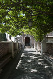 Shaded path. In the garden of Villa d'Este, Tivoli, Italy royalty free stock photography