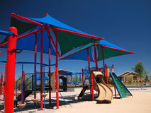 Shaded Playground Equipment. Brightly colored children's playground equipment covered by a canvas shade structure Royalty Free Stock Image