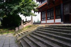 Shaded stone steps before aged Chinese building in morning Stock Photos