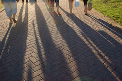 Shades. Long shades from people's legs Royalty Free Stock Photography