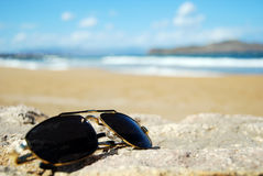 Shades on beach Royalty Free Stock Photos