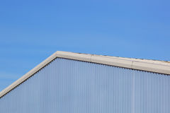 Shades of blue. A brightly colored business unit in shades of blue under a clear sky Stock Images