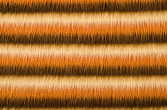 Shades of brown furry striped background. Hairy stripes pattern. Stock Image
