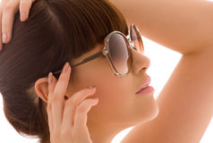 Shades. Closeup portrait of lovely woman in shades royalty free stock photography