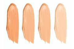 Shades of foundation On White Background. Closeup of different tones of liquid foundation stock image