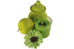 Shades of green. Isolates. A burning candle with a decorative green flower, a green apple and a sugar bowl. Still life. Four subjects. All shades of green Royalty Free Stock Photos