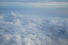 Shades of light blue color sky and floating white cloudscape heaven view from airplane window Royalty Free Stock Images