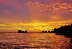 Shades of pink. In the Maldives, an unusually beautiful sunsets and sunrises. Each time the sky lights up with all the new colors. It seems that nature as a Royalty Free Stock Image