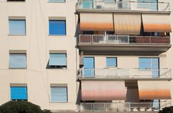 Shades pulled against high-UV afternoon. On an apartment building stock photography
